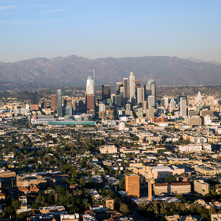 Aerial view of downtown Los Angeles with mountains in the background