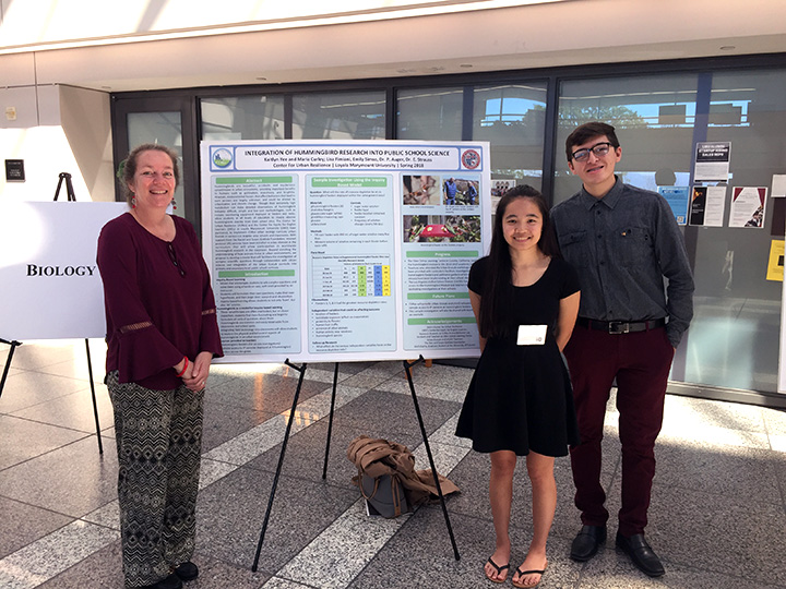Maria Curley, a CURes Education Specialist, Kaitlyn Yee, LMU class of 2018, and David Ramirez, LMU class of 2021, present their work on hummingbird metabolism and activities in University Hall