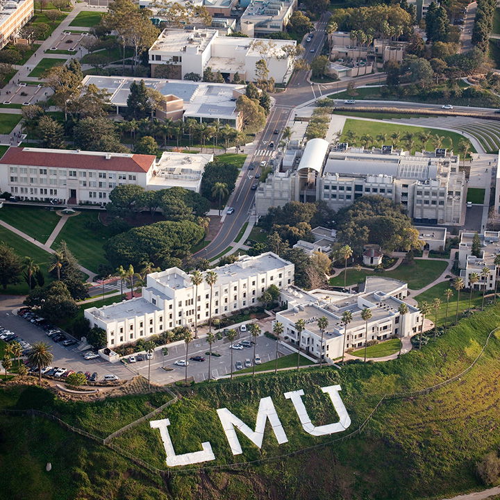 An aerial view of Xavier Hall and the LMU letters on the bluff