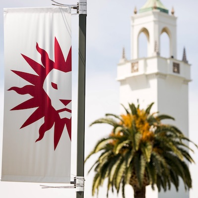 LMU spirit mark flag and chapel tower in the distance